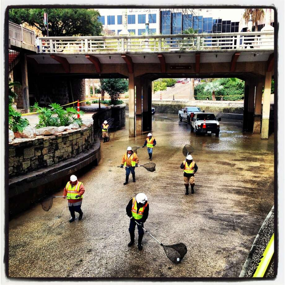 Crews scour the River Walk bottom in early January for large debris.