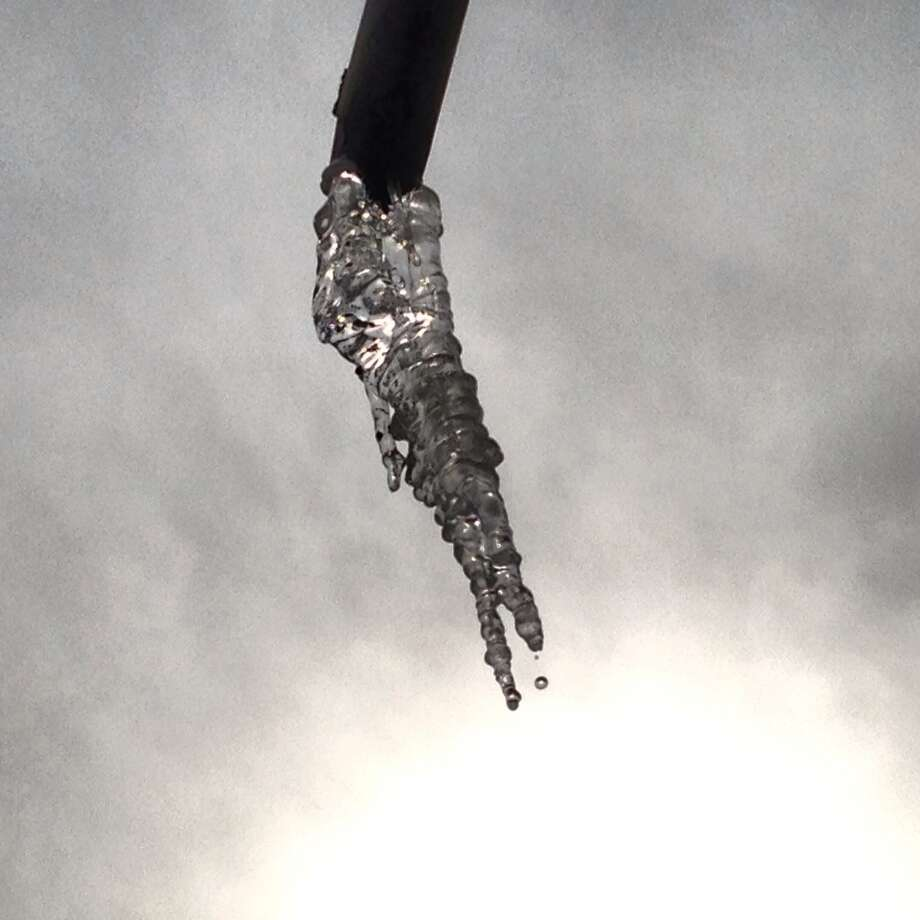 An icicle hangs off Houston Street the afternoon of Jan. 6.