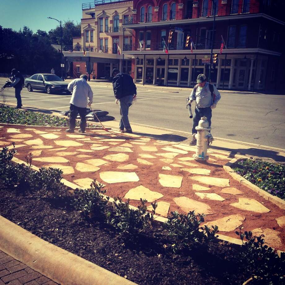 New pavers are installed in front of HemisFair Park on Jan. 15.
