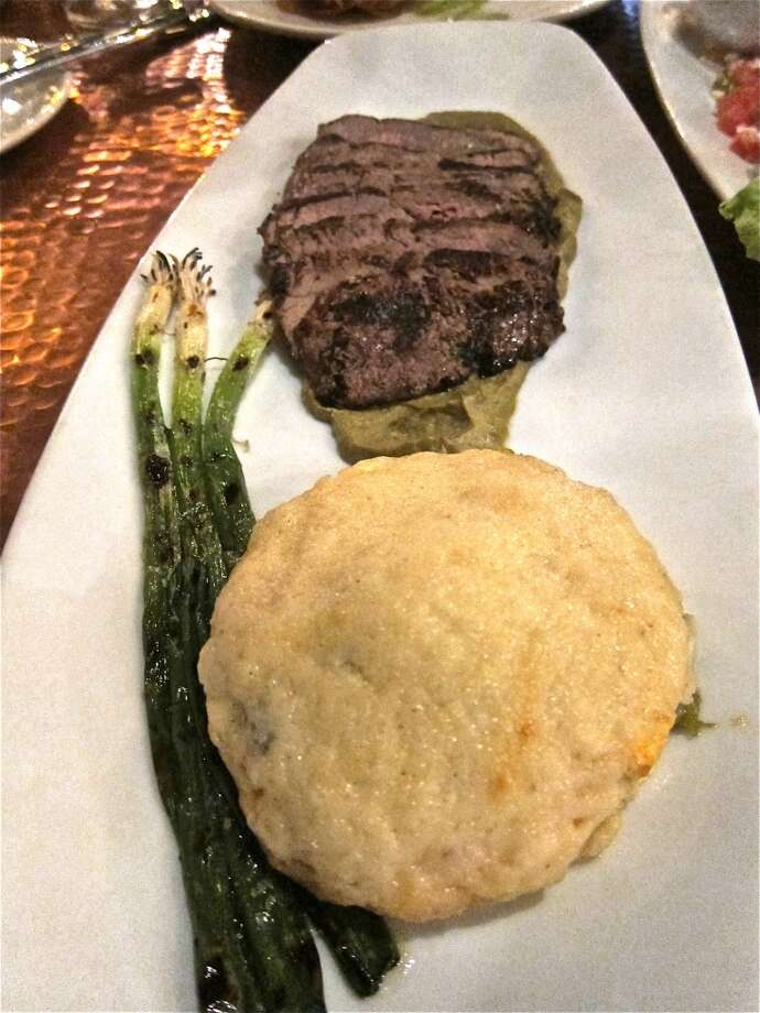 Grilled flank steak with zucchini and walnut mole, plus jalapeño scalloped potatoes, at Trenza. Photo: Alison Cook