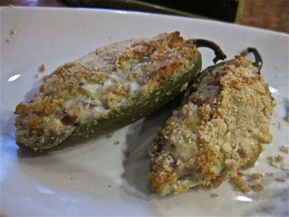 Lemon-crusted jalapeños stuffed with ricotta, blue cheese and bacon, at Trenza. Photo: Alison Cook