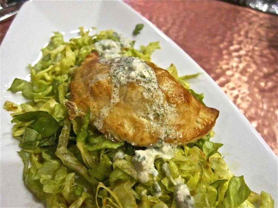 Chicken tikka masala empanada at Trenza. Photo: Alison Cook