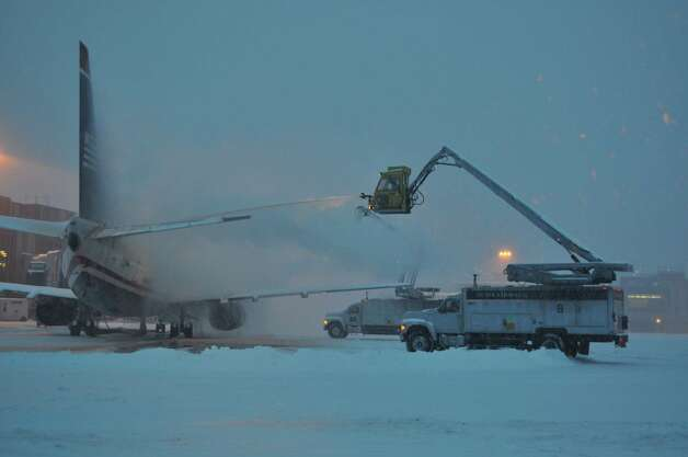 A crew de-ices a plane for U.S. Airway at Albany International Airport on Wednesday morning. (Courtesy Albany International Airport)