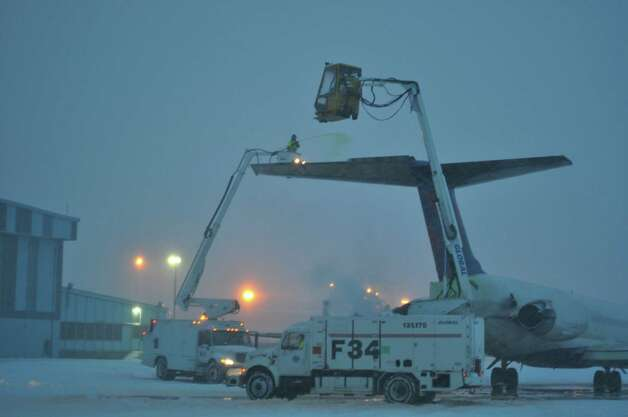 A crew de-ices a plane for Delta at Albany International Airport on Wednesday. (Courtesy Albany International Airport)