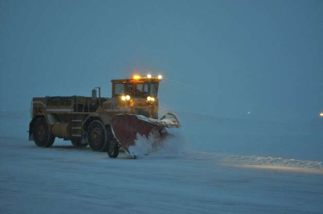 A plow clears the snow at Albany International Airport on Wednesday. (Albany International Airport)