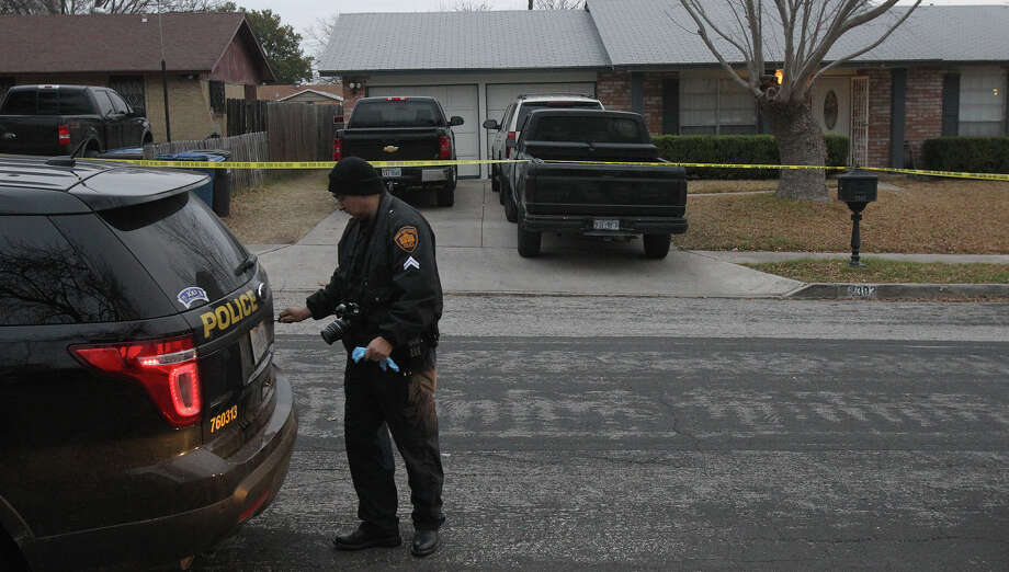 A San Antonio police officer works Wednesday February 5, 2014 at the scene in front of a home on the 2300 block of Marilyn Kay in Northwest San Antonio where a 31-year-old man was allegedly shot and killed around 3:00 a.m. . Police are still investigating. Photo: JOHN DAVENPORT, SAN ANTONIO EXPRESS-NEWS / ©San Antonio Express-News/Photo may be sold to the public