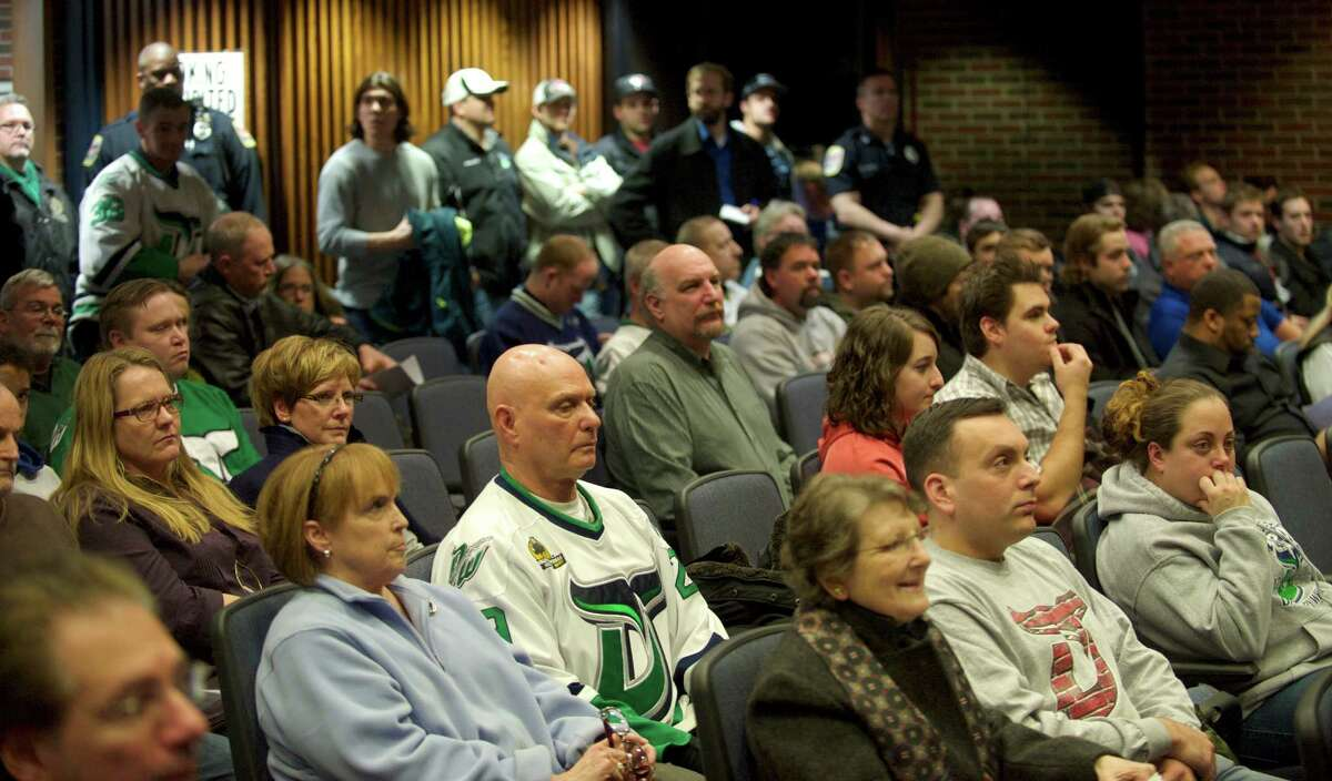 Fans of the Danbury Whalers attend the Danbury, Conn, City Council meeting on Tuesday night to show their support for the team in their dispute with the city over police and fire staffing at the Whalers games, on February 4, 2014.