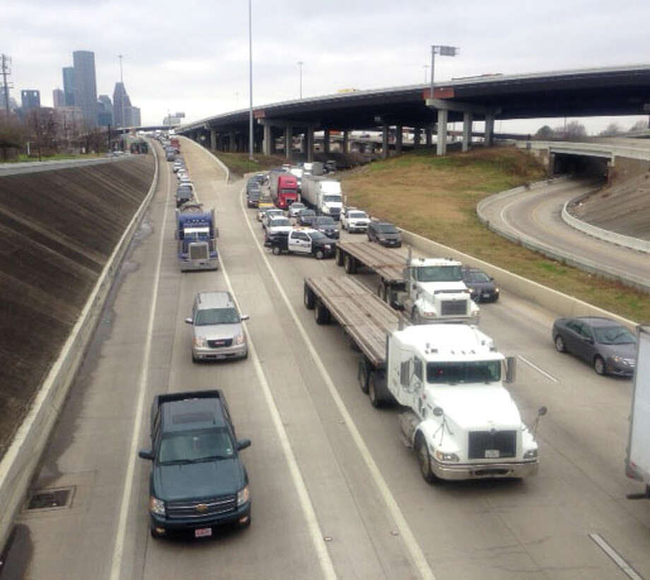 An accident involving a big rig truck slowed traffic on I-10 East outbound Wednesday morning. Photo: Cody Duty, Chronicle