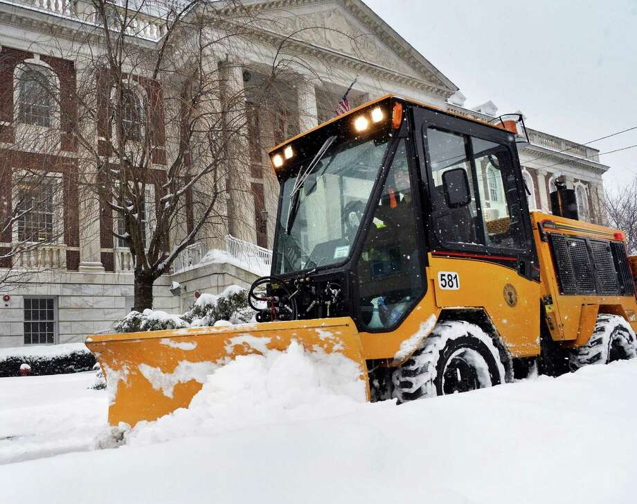 Richie Tabor plows the sidewalk around City Hall Wednesday, Feb. 5, 2014, in Schenectady, N.Y.  (John Carl D'Annibale / Times Union) Photo: John Carl D'Annibale / 00025615A