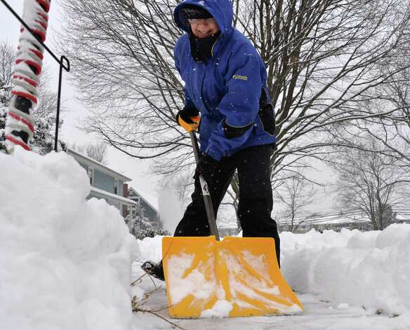 Barb Duffy shovel the walk at her Nelson Drive home Wednesday morning, Feb. 5, 2014, in Schenectady, N.Y.  (John Carl D'Annibale / Times Union) Photo: John Carl D'Annibale / 00025615A
