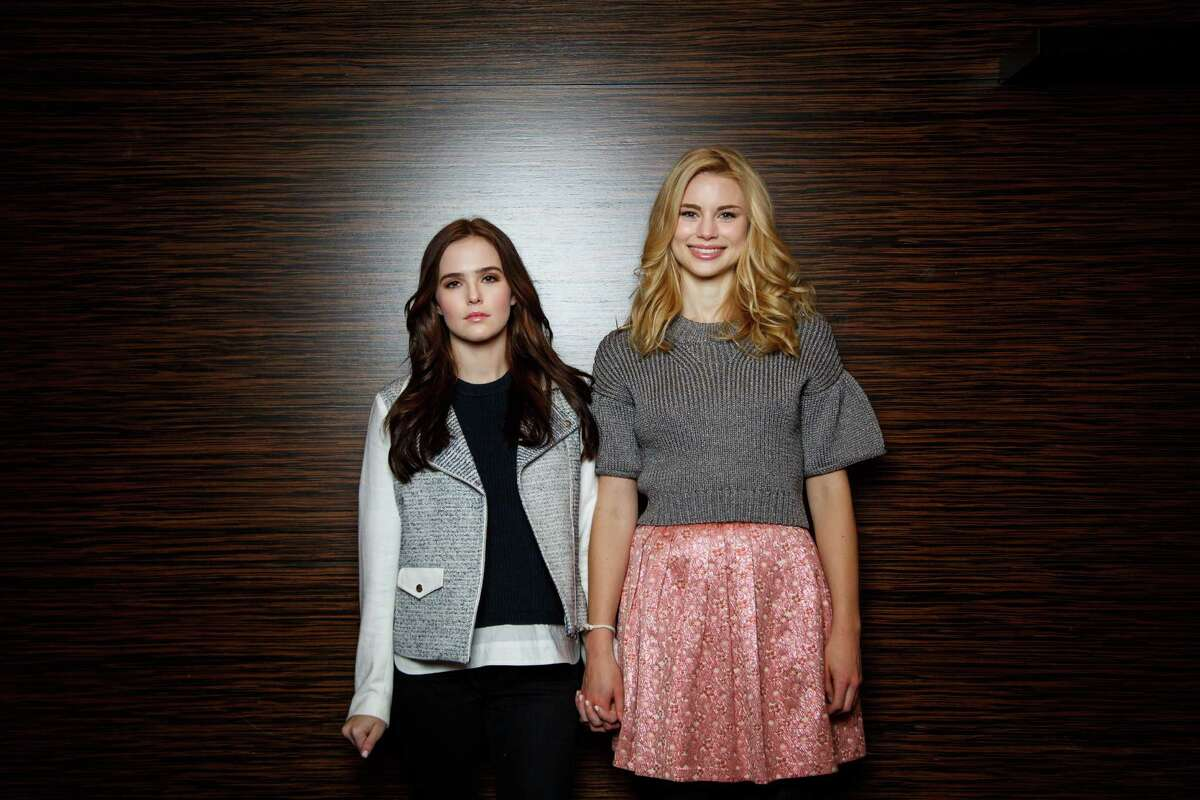 Zoey Deutch, left, and Lucy Fry star in the upcoming movie Vampire Academy, while posing for a photo at Hotel Derek, Wednesday, Jan. 29, 2014, in Houston. ( Michael Paulsen / Houston Chronicle )