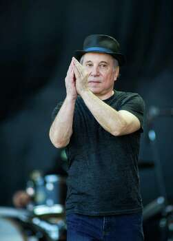 GLASTONBURY, ENGLAND - JUNE 26: Paul Simon performs live on the pyramid stage during the Glastonbury Festival at Worthy Farm, Pilton on June 26, 2011 in Glastonbury, England. The festival, which started in 1970 when several hundred hippies paid 1 GBP to attend, has grown into Europe's largest music festival attracting more than 175,000 people over five days.  (Photo by Ian Gavan/Getty Images) Photo: Ian Gavan, Stringer / 2011 Getty Images