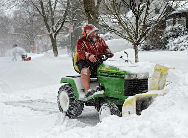 Jim Bethell, left, and Brian Chakurmanian of Guilderland do the good neighbor chore of plowing out the driveways of elderly neighbors on Norwood St. Wednesday, Feb. 5, 2014 in Albany, N.Y.  (Lori Van Buren / Times Union) Photo: Lori Van Buren, Albany Times Union / 00025615A