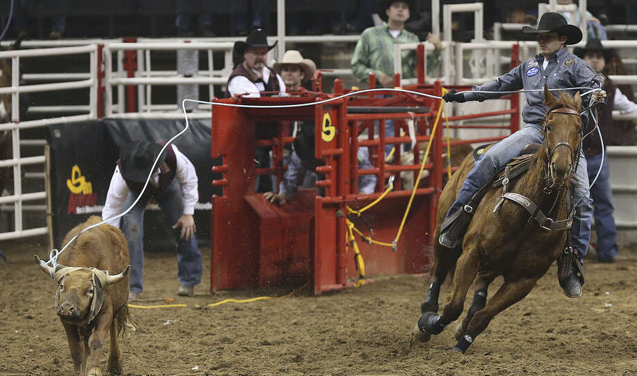 Team roper Kaleb Driggers (above) has either set or tied the arena record in his event at the San Antonio Stock Show & Rodeo.   He's back this year with new partner Patrick Smith. Photo: Express-News File Photo / ©2013 San Antonio Express-News