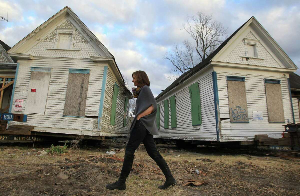 Anne Whitlock (pictured) and husband Michael Skelly transplanted six homes to the lot near where they will live in Firehouse No. 2 on Sampson Street. One of the homes will be their guest house; they are trying to entice friends to buy and rehab the others.