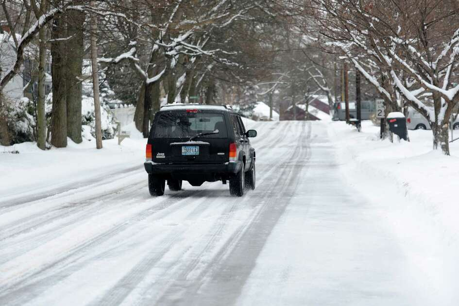 Roads remained icy into the morning in Fairfield, Conn. after an overnight snowstorm on Wednesday, Feb. 5, 2014. Most towns and cities got at least 7 inches of snow before temperatures rose after dawn and a changeover to sleet and freezing rain began.
