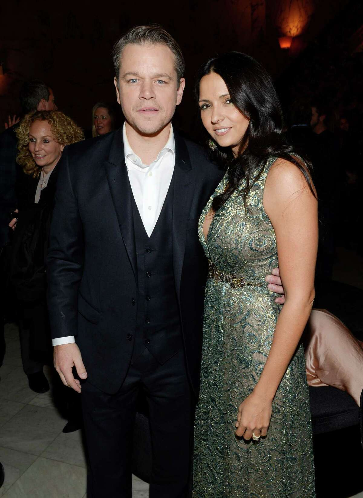 """Actor Matt Damon and wife Luciana Barroso attend """"The Monuments Men"""" premiere party at the Metropolitan Club on Tuesday, Feb. 4, 2014 in New York. (Photo by Evan Agostini/Invision/AP) ORG XMIT: NYEA132"""
