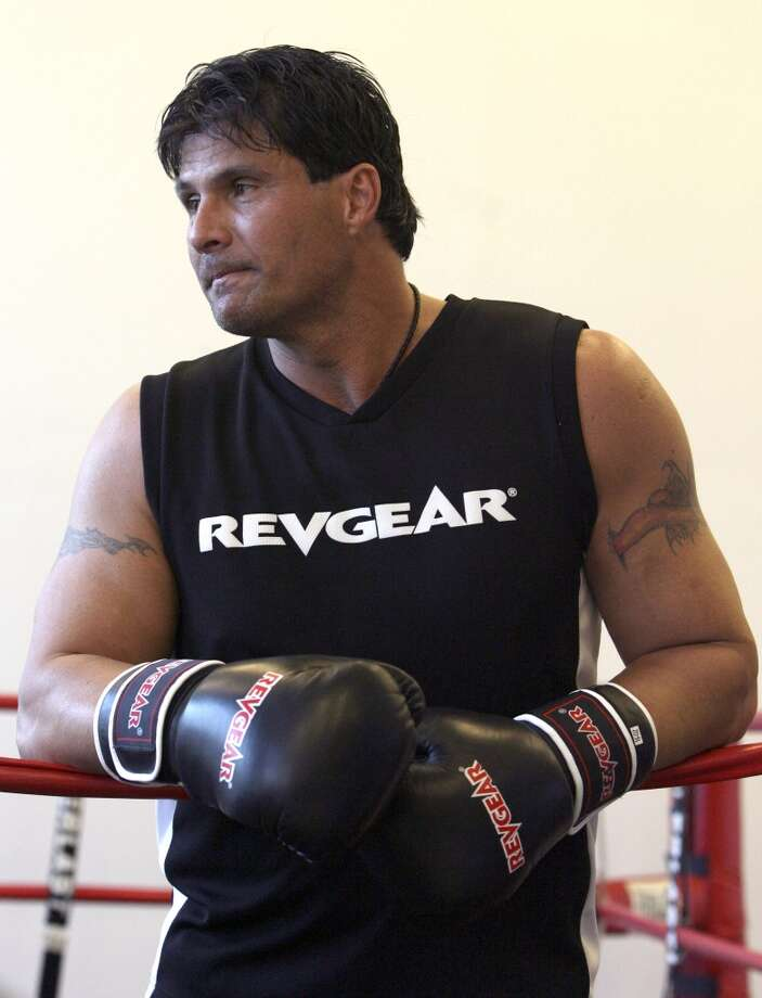 "Former baseball player Jose Canseco takes a break from a training session, Thursday, Jan. 22, 2009 in New York. Canseco might want to dust off that ""Bash Brother"" moniker. He needs a colorful nickname for his ring introduction in a celebrity boxing match Saturday against Danny Bonaduce.  (AP Photo/Mary Altaffer) Photo: Mary Altaffer, AP"