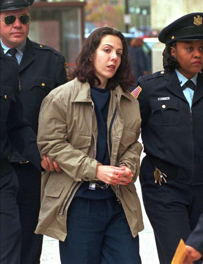 "FILE--Amy Fisher is escorted into the federal courthouse in Buffalo, N.Y., in this Sept. 26, 1996, file photo. Fisher, the ""Long Island Lolita,"" was to take on figure skater Tonya Harding on Fox TV's new show, ""Celebrity Boxing,"" but the New York State Parole Board decided the appearance ""would not be conducive to her continued parole supervision and would send an inappropriate message to victims of violent crime,"" spokesman Tom Grant said Tuesday, March 2, 2002. (AP Photo/Bill Sikes) Photo: BILL SIKES, AP"