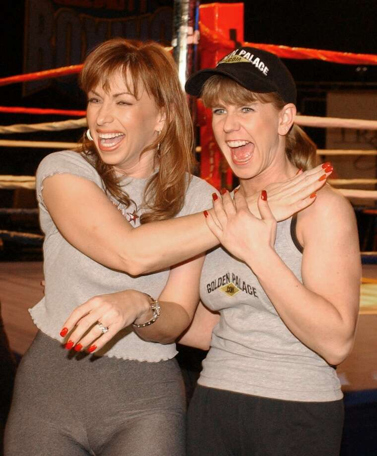 "Tonya Harding, right, and Paula Jones, left, pose for photographers after the weigh-in for their fight on ""Celebrity Boxing,"" Wednesday, March 6, 2002, in the Hollywood section of Los Angeles.  The television special, which pits celebrities against each other in the ring, will air March 13 on Fox. (AP Photo/Rene Macura)  HOUCHRON CAPTION  (03/08/2002):  Paula Jones, left, and Tonya Harding cut up after the weigh-in for their fight on Celebrity Boxing on Wednesday in Los Angeles. The television special will air next week on the Fox Network. Photo: RENE MACURA, AP"
