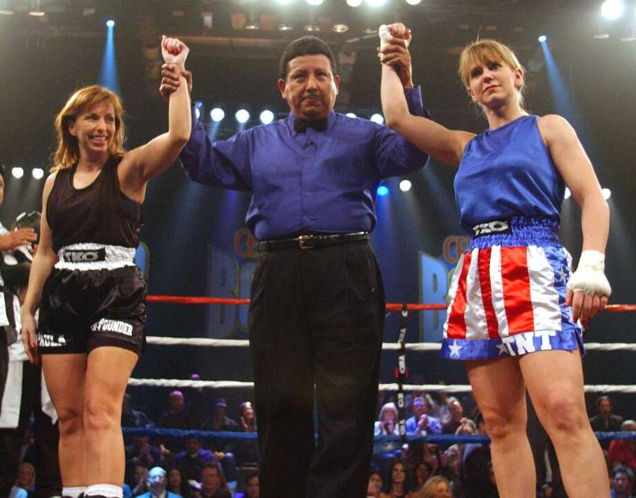 Paula Jones, left, and Tonya Harding get ready to square off during a Celebrity Boxing match at KTLA Studios in Los Angeles on March 7, 2002. The match aired on FOX Television Wednesday, March 13, 2002, on FOX Television. The referee at center is unidentified. (AP Photo/FOX, Handout) Photo: AP