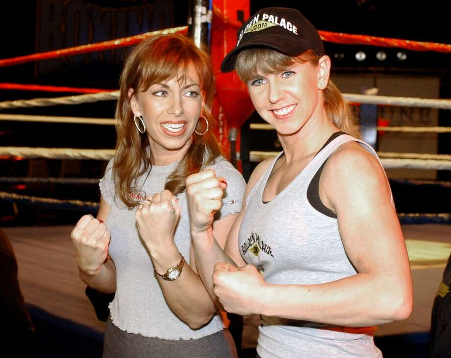 "Figure skater Tonya Harding, right, poses with Paula Jones, left, after the weigh-in for their fight on ""Celebrity Boxing,"" Wednesday, March 6, 2002, in the Hollywood section of Los Angeles.  The television special, which pits celebrities against each other in the ring, will air March 13 on Fox. (AP Photo/Rene Macura) Photo: RENE MACURA, AP"
