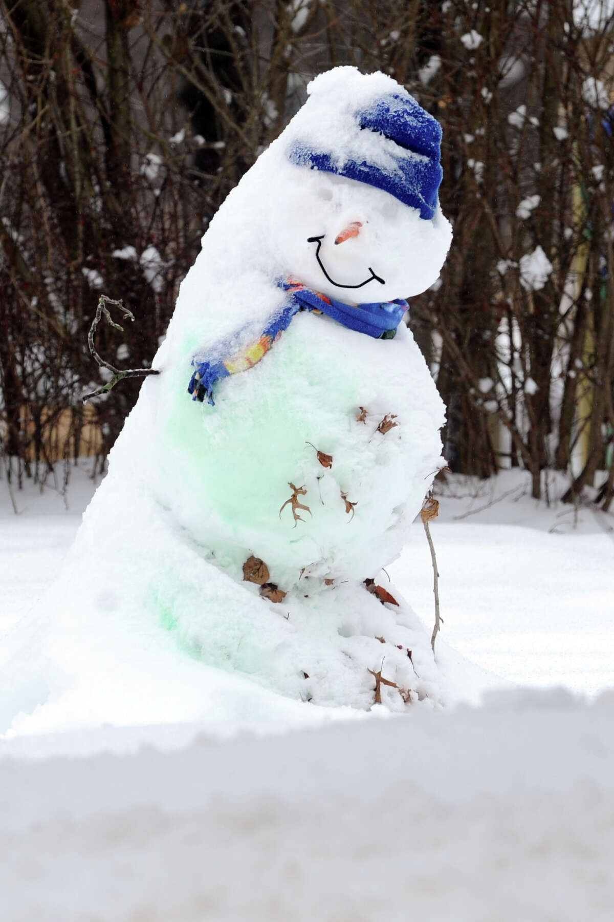 A snowman covered by a new coating of snow in Stratford, Conn., Feb. 5, 2014.