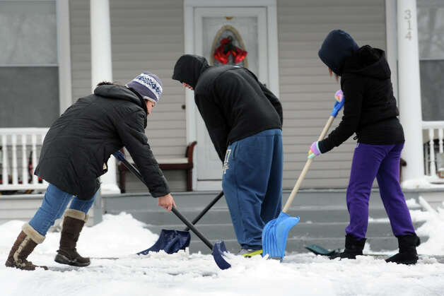 Neighbors shovel a driveway in Stratford, Conn., Feb. 5, 2014. Photo: Ned Gerard / Connecticut Post