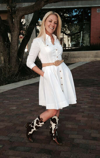 Sara Stumberg Walker is rodeo chic in a Diane von Furstenberg white shirtdress, cinched at th