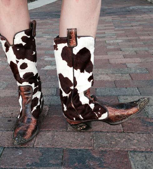 Sara Stumberg Walker is rodeo chic in a Diane von Furstenberg  white shirtdress, cinched at