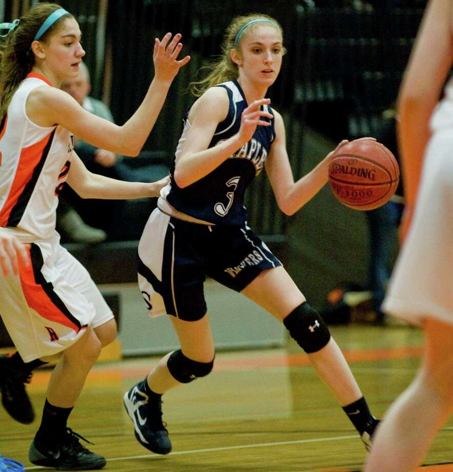 Ridgefield High School's Carly Mercede tries to prevent Staples High School's Abby Lustig from move the ball to the basket during a game at Ridgefield. Tuesday, Jan. 28, 2014. Photo: Scott Mullin / The News-Times Freelance