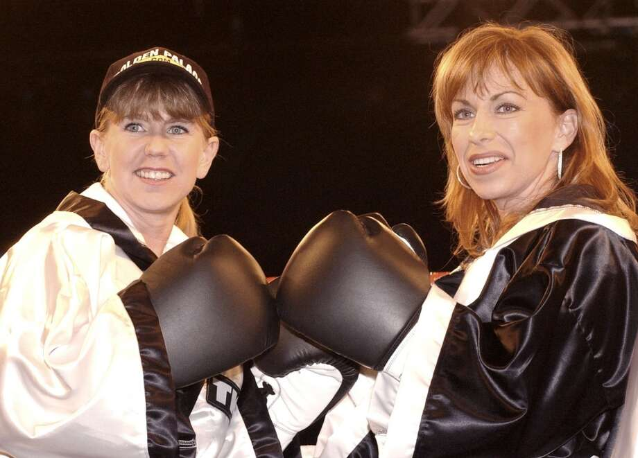 "Tonya Harding, left, and Paula Jones pose with their boxing gloves after the weigh-in for their fight on ""Celebrity Boxing,"" Wednesday, March 6, 2002, in the Hollywood section of Los Angeles. The television special, which pits celebrities against each other in the ring, will air March 13 on Fox Television. (AP Photo/Rene Macura) Photo: RENE MACURA, AP"