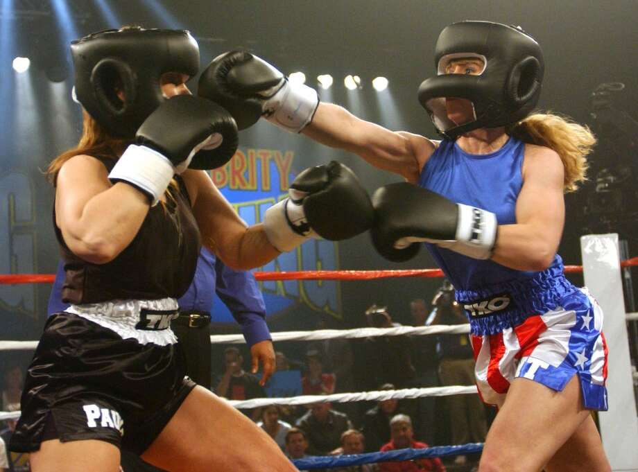 Tonya Harding, right, throws a jab at Paula Jones as the two square off during a Celebrity Boxing match at KTLA Studios in Los Angeles on March 7, 2002. The match aired on FOX Televison Wednesday, March 13, 2002. (AP Photo/FOX, Handout)   HOUCHRON CAPTION  (03/17/2002):  Former Olympic ice skater Tonya Harding, right, lands a punch to the head of Paula Jones during Fox-TV's celebrity boxing show. Harding beat Jones by technical knockout. Photo: AP