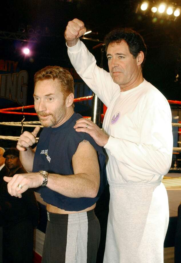 "Former ""Brady Bunch"" star Barry Williams, right, poses with former ""Partridge Family"" star Danny Bonaduce, left, after the weigh-in for their fight on ""Celebrity Boxing,"" Wednesday, March 6, 2002, in the Hollywood section of Los Angeles. The television special, which pits celebrities against eachother in the ring, will air March 13 on Fox. (AP Photo/Rene Macura) Photo: RENE MACURA, AP"
