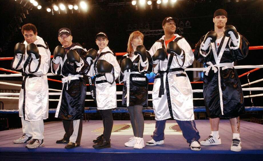 "From left, Barry Williams, Danny Bonaduce, Tonya Harding, Paula Jones, Todd Bridges and Rob Van Winkle, formerly known as Vanilla Ice, pose with boxing gloves after the weigh-in for their fights for Fox TV's ""Celebrity Boxing,"" Wednesday, March 6, 2002, in of Los Angeles. The show is scheduled to air March 13. (AP Photo/Rene Macura) Photo: RENE MACURA, AP"