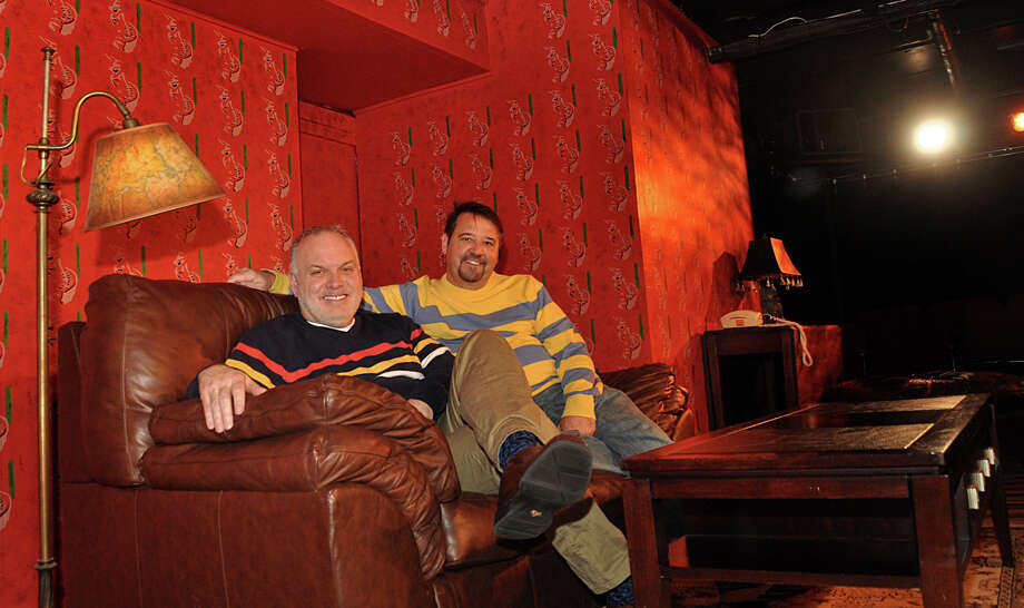 "Jim Schilling, right, and Kevin Connors, the co-founders of the Music Theatre of Connecticut, on the set of ""God of Carnage,"" the current production at its Westport theater. The organization plans to move to a site on Westport Avenue in Norwalk later this year. Photo: Nancy Guenther Chapman / Westport News contributed"