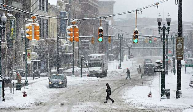Wednesday's snowstorm kept Schenectady's State Street nearly deserted, Feb. 5, 2014, in Schenectady, N.Y.  (John Carl D'Annibale / Times Union) Photo: John Carl D'Annibale / 00025615A