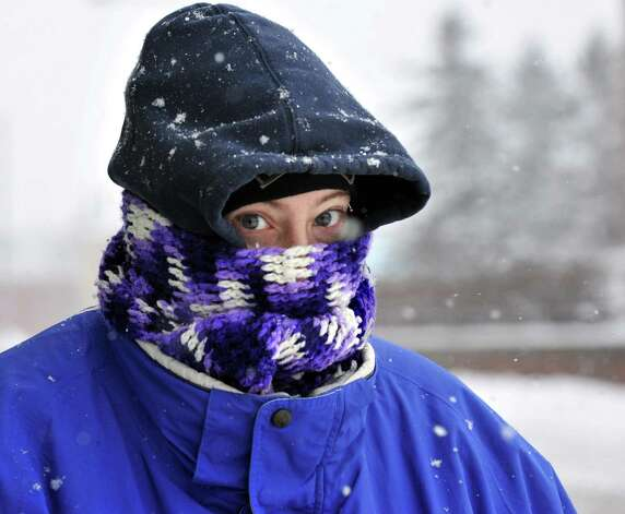 Rebecca Dykeman of Schenectady stays bundled up against the storm as she walks along Layfayette Street Wednesday Feb. 5, 2014, in Schenectady, NY.  (John Carl D'Annibale / Times Union) Photo: John Carl D'Annibale / 00025615A