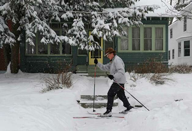 UAlbany employee Tine Reimers of Guilderland cuts through Norwood St. on her cross country skies from work to her home in Woodscape Wednesday, Feb. 5, 2014, in Albany, N.Y.  (Lori Van Buren / Times Union) Photo: Lori Van Buren / 00025615A