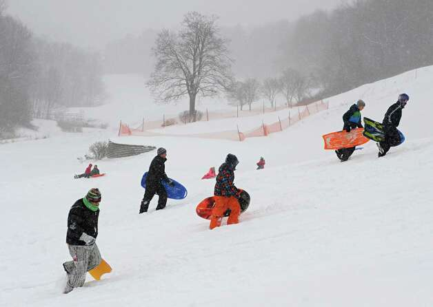 Sledders of all ages took to the fresh snow at Capital Hills Golf Course Wednesday, Feb. 5, 2014, in Albany, N.Y.  (Lori Van Buren / Times Union) Photo: Lori Van Buren / 00025615A
