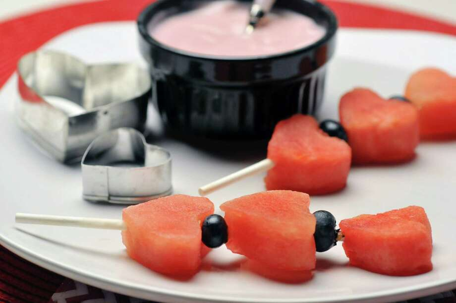 A view of watermelon fruit kebobs with a raspberry dip, photographed at the Times Union studio on Tuesday, Jan. 21, 2014 in Colonie, NY.  (Paul Buckowski / Times Union) Photo: Paul Buckowski / 00025296A