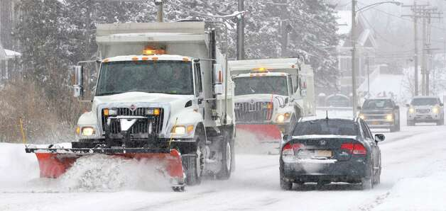 Town of Cohoes plow operators clear snow off of Columbia St.  Wednesday, Feb. 5, 2014, in Cohoes, N.Y.  (Paul Buckowski / Times Union) Photo: Paul Buckowski / 00025615A
