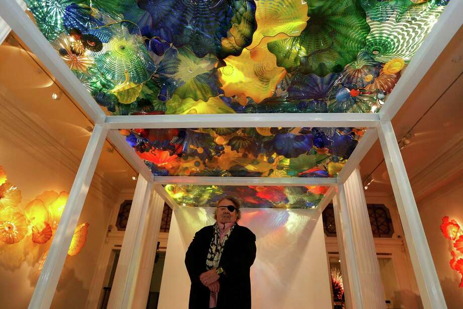 Artist Dale Chihuly poses underneath his glass sculpture 'Persian Pergola Ceiling' during the launch of an exhibition of his work 'Dale Chihuly: Beyond the Object' at the Halcyon Gallery in London, Tuesday, Feb. 4, 2014. Photo: Sang Tan, AP / AP2014