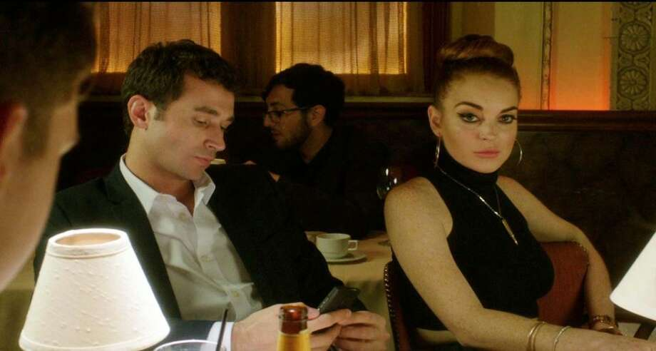 "The Canyons (2013) Paul Schrader's erotic thriller was written by Bret Easton Ellis and touches on the death of cinema at the hands of the smart phone. Real-life porn star James Deen plays Christian, a trust-fund brat, and Lindsay Lohan is his girlfriend, Tara, who is addicted to his money. Christian is a producer but prefers to make films of his own – mostly sexcapades – with his phone. Tara's tryst with an actor eventually leads to Christian losing it. This isn't Schrader's first time exploring a more seedy side of society. The ""Taxi Driver"" writer's credits also include ""Hardcore,"" ""American Gigolo"" and ""Auto Focus."" The critics' take: Too soon for a consensus on Rotten Tomatoes. (Photo By Associated Press)"
