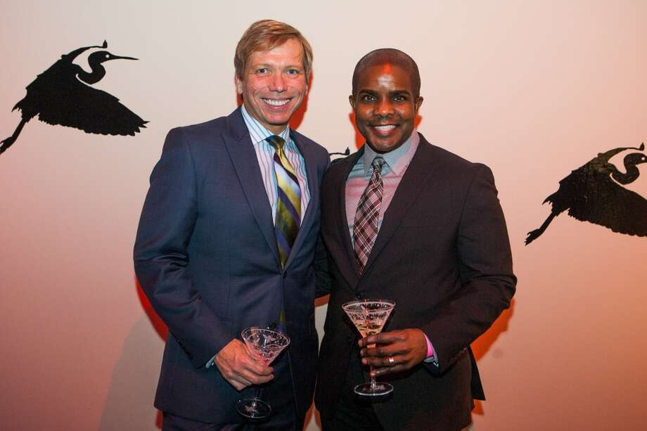 Jonathon Glus and Alton Day, a past chair of the event, pose during Martini Madness at the Houston Center for Contemporary Craft Thursday January 30. Martini Madness is a society event benefitting the Center. (Michael Starghill, Jr.) Photo: Michael Starghill, Jr.