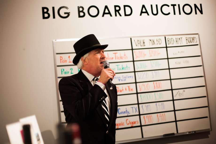 Wade Wilson encourages people to bid on the auction during Martini Madness. Photo: Michael Starghill, Jr.