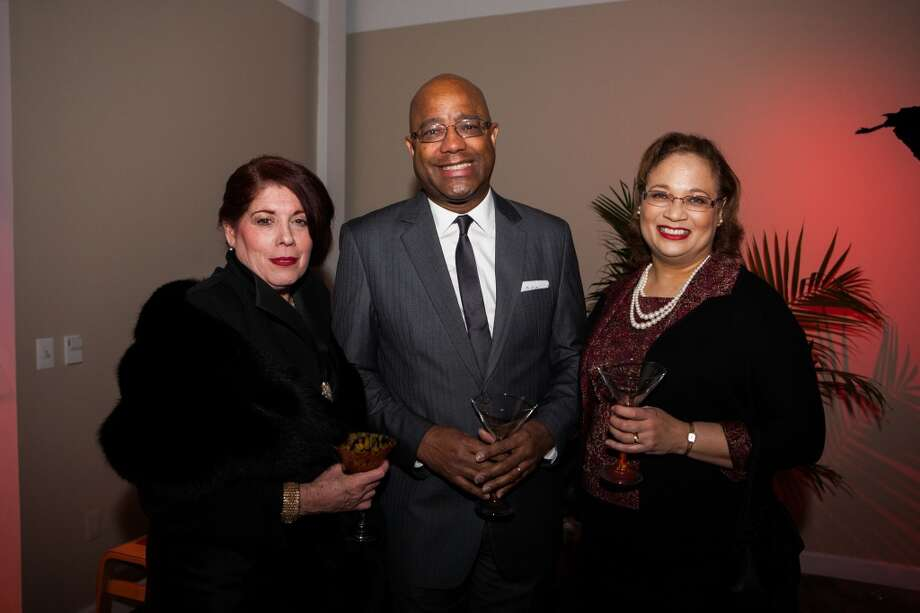 Elise Glattier-Hollingsworth, Michael Pearson and Lisa Pearson pose during Martini Madness Photo: Michael Starghill, Jr.