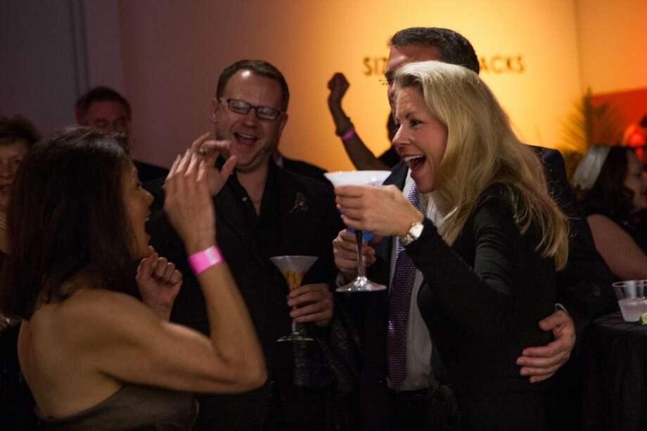 Scarlet Collings celebrates winning one of the auction items during Martini Madness Photo: Michael Starghill, Jr.