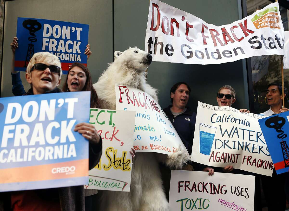 In this Sept. 13, 2013 file photo, environmental demonstrators in Oakland, Calif., protest California Gov. Jerry Brown's position on natural gas fracking.