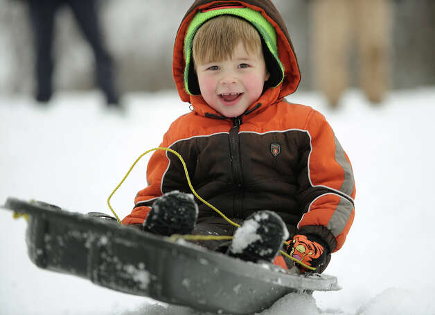 Liam Scheck, 3, of Stratford, enjoys an afternoon of sledding on Academy Hill in Stratford, Conn. on Wednesday, February 5, 2014. Photo: Brian A. Pounds / Connecticut Post